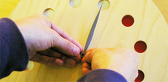 Lift the needle vertically with your fingertips